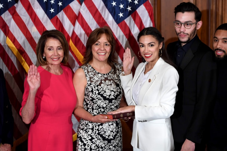 Image: Speaker of the House Nancy Pelosi performs a ceremonial swearing-in for U.S. House Representative Alexandria Ocasio-Cortez, D-NY