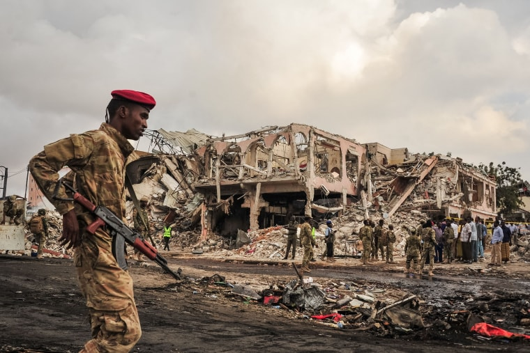 Image: Somali soldiers patrol on the scene after a truck bomb exploded in Mogadishu on Oct.15, 2017.