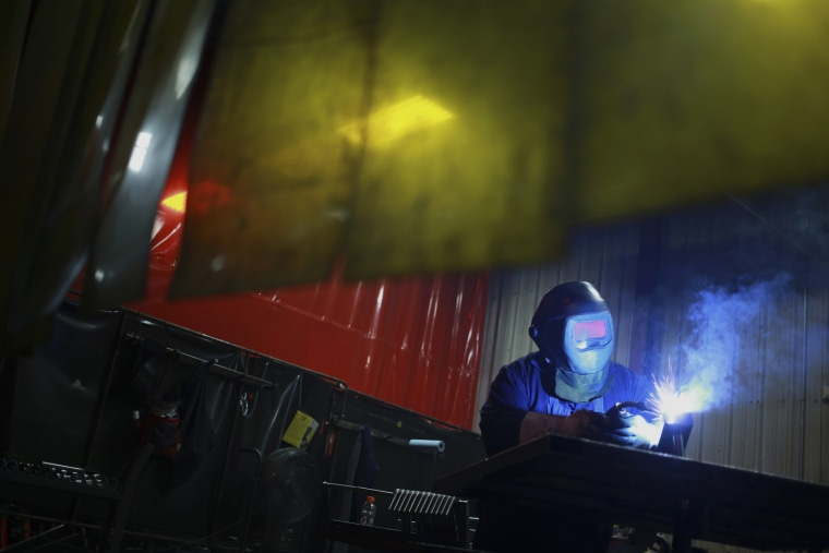 Image: A welder works during production at the Life Fitness manufacturing facility in Falmouth, Kentucky, on April 9, 2015.