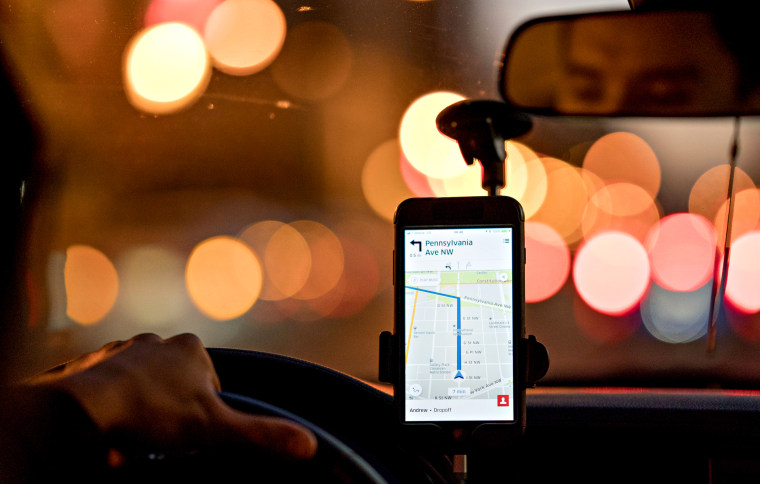 Image: A driver uses the Uber car service app in Washington, D.C., in 2017.