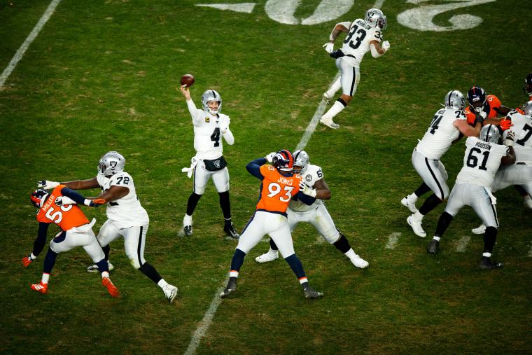 Image: Oakland Raiders quarterback Derek Carr throws a pass against the Denver Broncos in Colorado on Dec. 29, 2019.