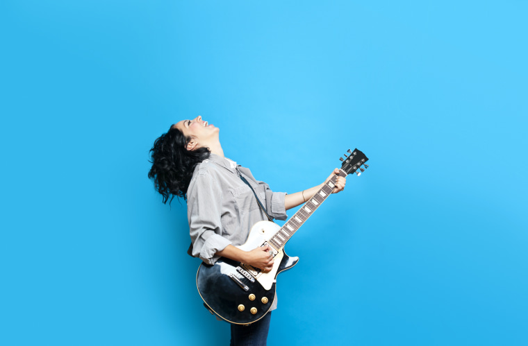 Image: Woman playing guitar