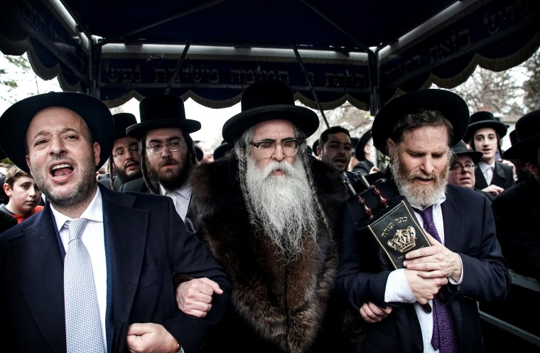 Image: Rabbi Chaim Rottenberg celebrates the arrival of a new Torah at his home in Monsey, N.Y., the day after five people were injured in a machete attack during a Hannukah celebration at his home on Dec. 29, 2019.