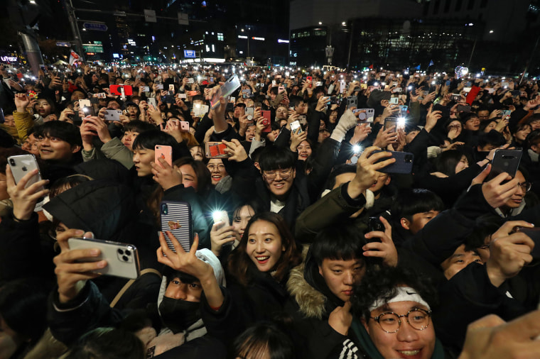 Revellers gather to celebrate the new year at the Bosingak pavilion on Jan. 1, 2020 in Seoul, South Korea.