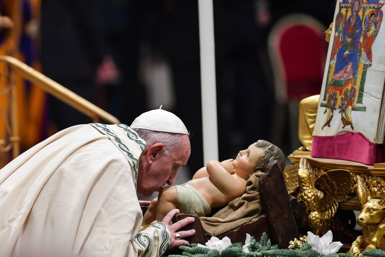 "Pope Francis kisses the baby Jesus Christ during the ""Te Deum"" prayer for the year 2019 in Saint Peter's Basilica on Dec. 31, 2019."