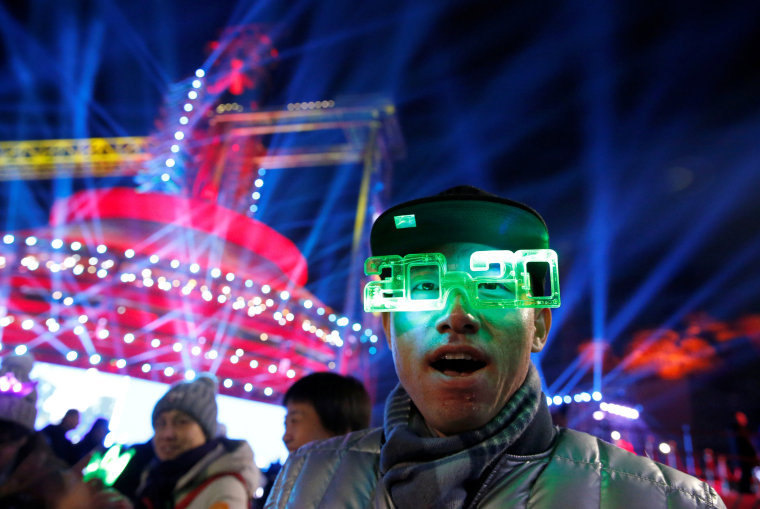 Image: A man takes part in the event of New Year's Eve countdown celebration at Shougang Industrial Park, one of the venues for the Beijing 2022 Olympics, in Beijing