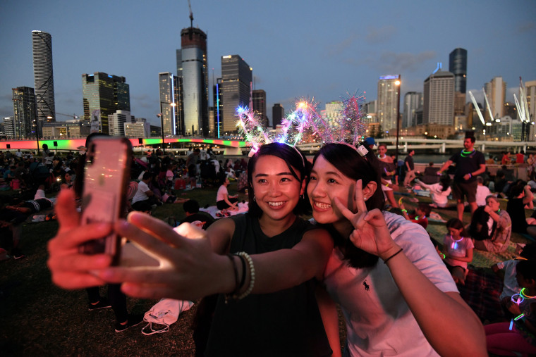 Image: Mizuki and Tsubasa wait to watch the New Year's Eve fireworks at South Bank in Brisbane