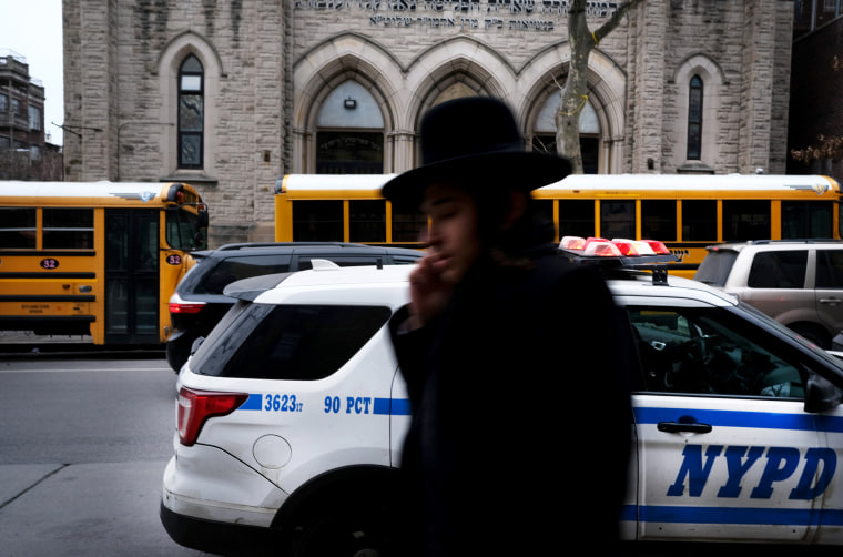 Image: An Orthodox Jewish man walks through Brooklyn the day after five people were stabbed at a Hannukah gathering in Monsey, N.Y., on Dec. 29, 2019. Security has been increased in some Jewish communities following recent attacks.