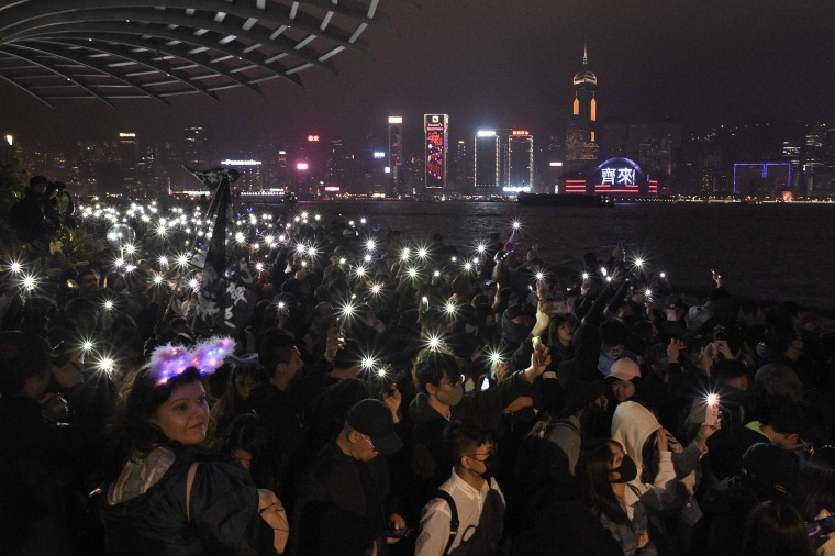 Anti-government protesters in Hong Kong held hands and formed human chains across the city as they carried their months-long movement and its demands into 2020 with midnight countdown rallies.