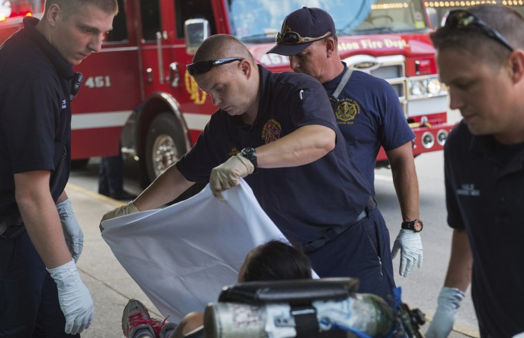 Emergency responders tend to a woman believed to be overdosing on methamphetamine in Charleston, West Virginia, in July.