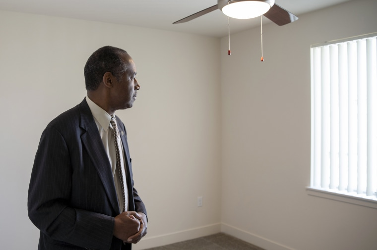 Image: Housing and Urban Development Secretary Ben Carson stands in an empty apartment in a HUD funded complex in Aurora, Colorado, on July 30, 2018.