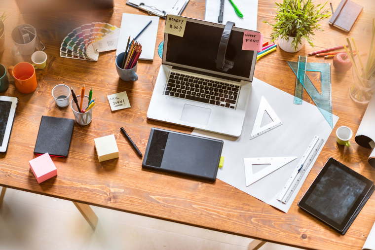 Image: Messy desk of young startup coworking business