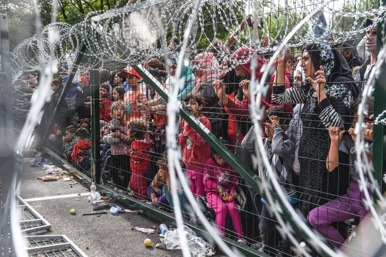 Image: Refugees behind the fence at the Hungarian border with Serbia on Sept. 16, 2015.