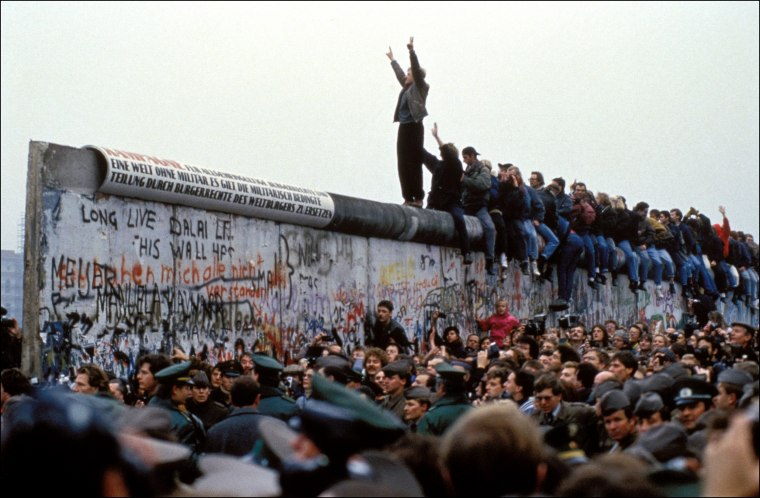 Image: Celebrations on the Berlin Wall after the government announced people could cross the border freely in Germany on Nov. 12, 1989.