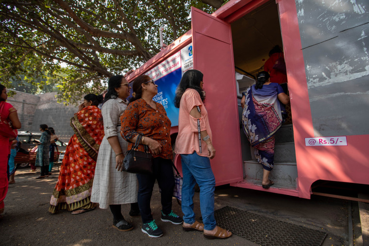 Image: Women wait to use the Shaniwar Wada bus toilet for women in Pune, India