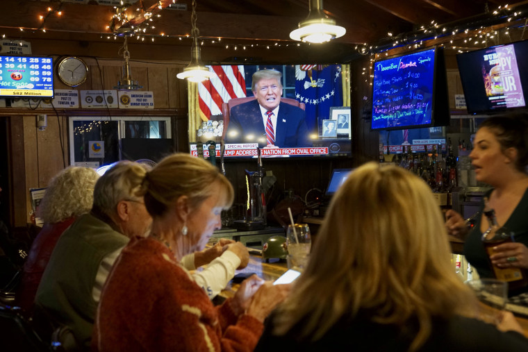 Members of American Legion Post 416 watch President Donald Trump speak on Jan. 8, 2019 in Encinitas, California.