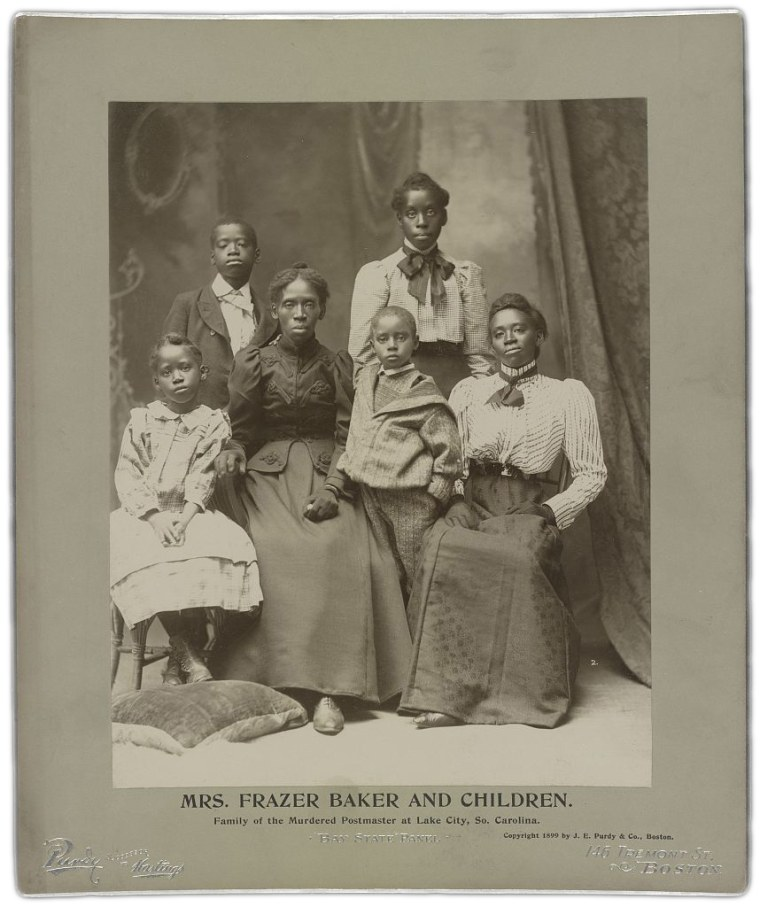 Lavinia Baker and her five surviving children after the lynching of her husband and baby on Feb. 22, 1898.