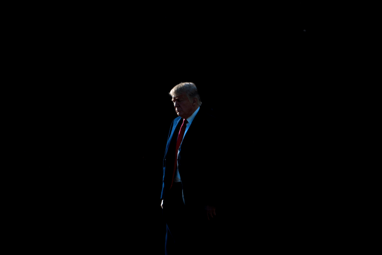 Image: President Donald Trump walks on the South Lawn of the White House on Dec. 21, 2017.