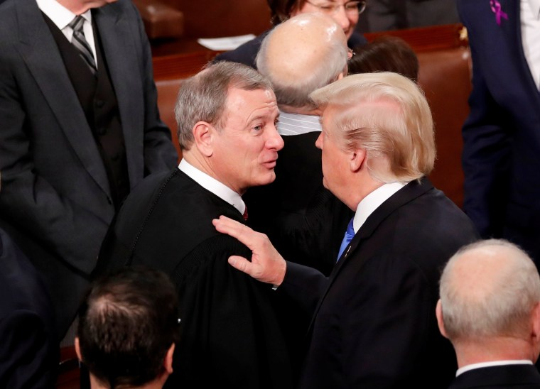 Image: President Trump greets Justice Roberts after delivering his State of the Union address in Washington