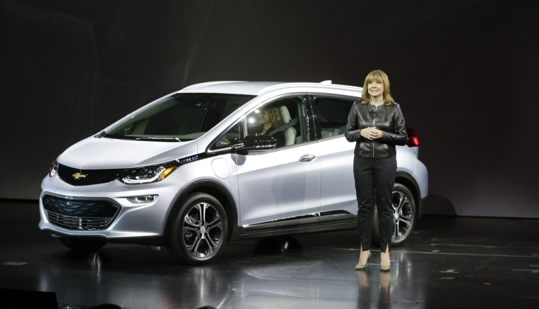 General Motors Co. CEO Mary Barra stands next to the Chevrolet Bolt EV electric car at CES International in 2016.