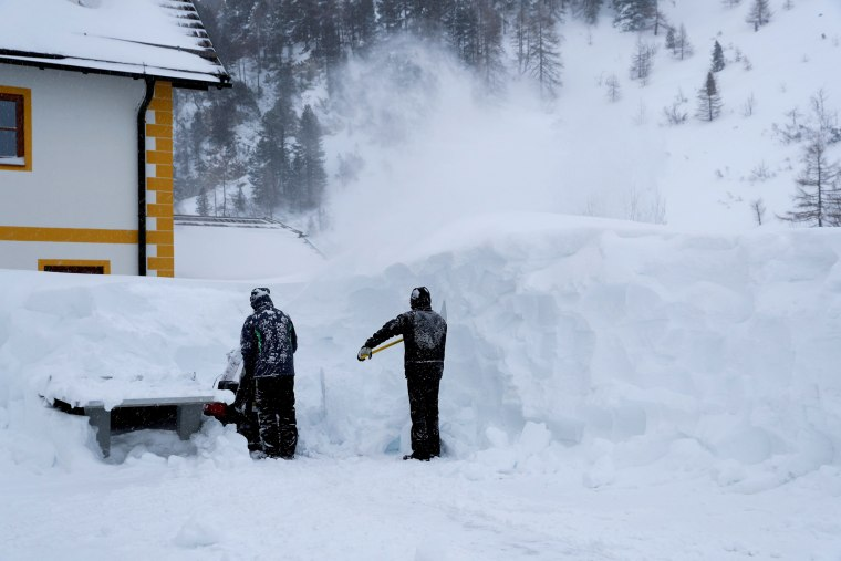 Image: Workers remove snow after a blizzard at the Obertauern ski resort in Austria on Jan. 10, 2019.