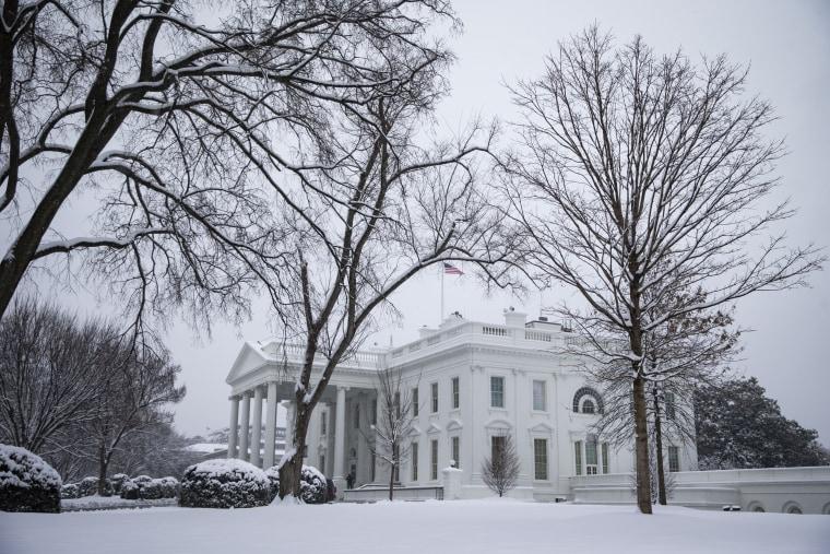 Image: Snow falls around the White House on Jan. 13, 2019.