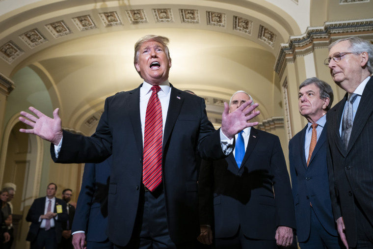 President Donald Trump, along with Vice President Mike Pence, Sen. Roy Blunt, R-Mo, and Senate Majority Leader Mitch McConnell, speaks to reporters after  the Senate Republican policy luncheon in Washington on Jan. 9, 2019.