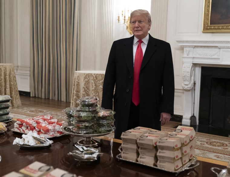 Image: United States President Donald J. Trump presents fast food to be served to the Clemson Tigers during White House visit