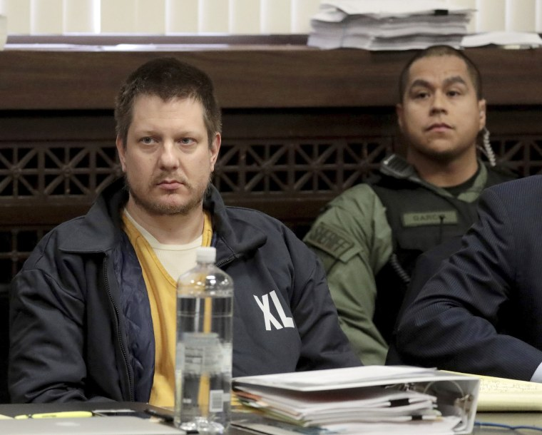 Image: Former Chicago police Officer Jason Van Dyke, left, appears for a hearing at the Leighton Criminal Court Building, in Chicago