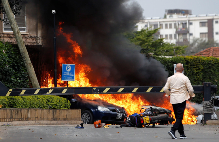 Image: Cars on fire at the Dusit hotel compound where explosions and gunshots were heard