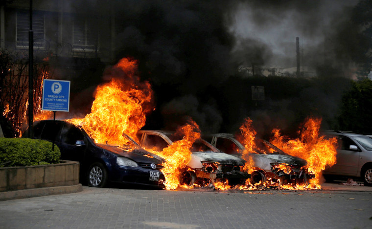 Image: Cars are seen on fire at the scene where explosions and gunshots were heard at the Dusit hotel compound, in Nairobi