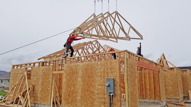 Members of Self-Help Homes build a home in Heber City, Utah.