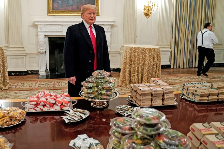 Image: U.S. President Donald Trump speaks in front of fast food provided for the 2018 College Football Playoff National Champion Clemson Tigers due to the partial government shutdown in the State Dining Room of the White House in Washington