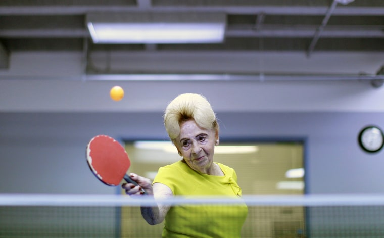 Holocaust survivor Betty Stein, 92, plays ping pong at a program for people with Alzheimer's and dementia at the Arthur Gilbert table tennis center in Los Angeles