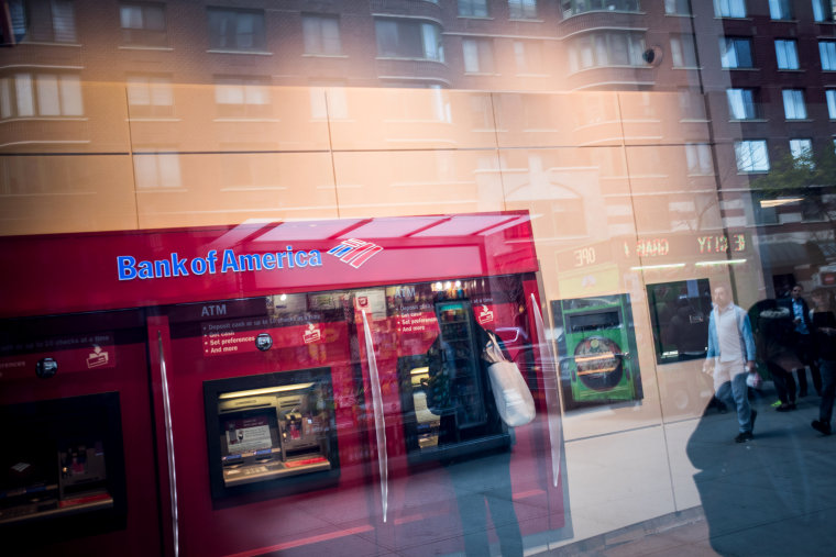 Image: A customer uses an ATM inside a Bank of America branch in New York on Oct. 12, 2016.