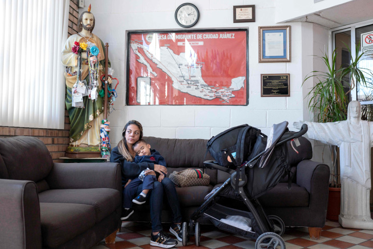 Image: Soredy, from Venezuela, holds her son, Santiago, inside a reception area of Casa del Migrante in Ciudad Juarez, Mexico, on Nov. 18, 2018.