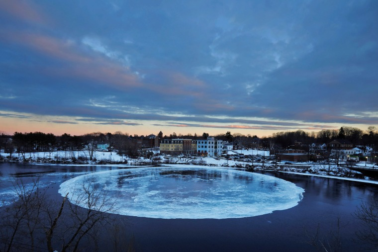 Image: A large, circular ice floe sits in the Presumpscot River in Westbrook