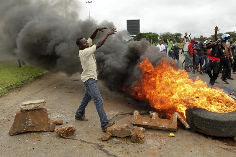 Image: A protest over the hike in fuel prices in Zimbabwe