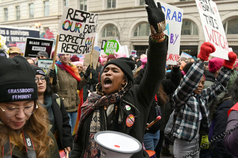 Image: Participants chant as they march up Pennsylvania Avenue during the Third Annual Women's March in Washington