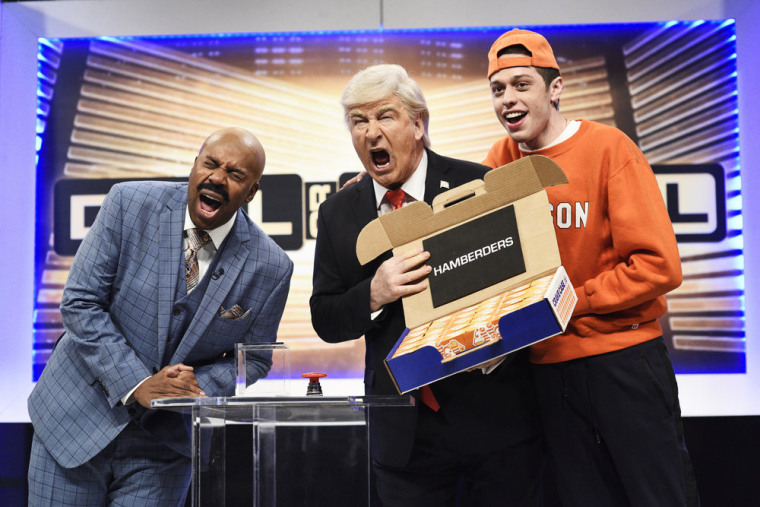 "Kenan Thompson as Steve Harvey, Alec Baldwin as Donald Trump, and Pete Davidson as a Clemson student on SNL's ""Deal or No Deal Cold Open"" sketch"