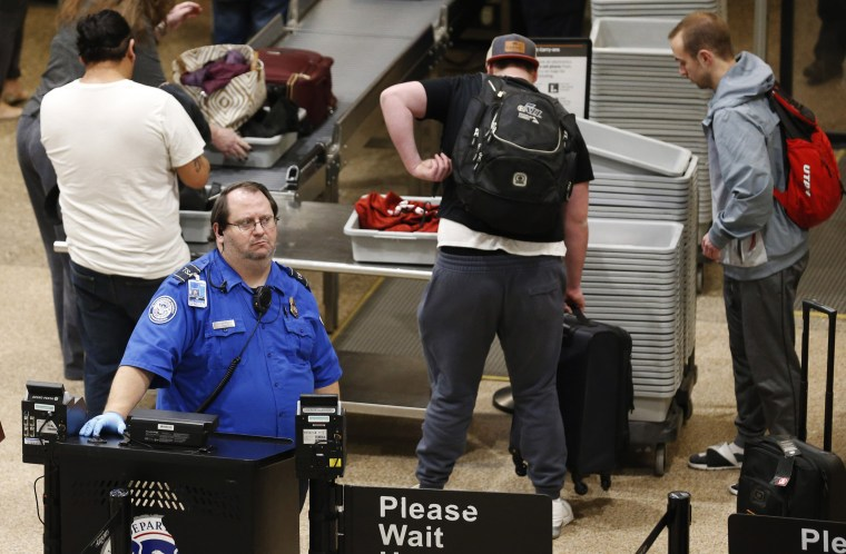 Image: A TSA worker at the Salt Lake City International Airport in Utah on Jan. 16, 2019.