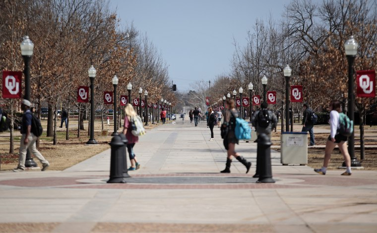 Image: Students walk on campus at the University of Oklahoma in Norman on March 11, 2015.