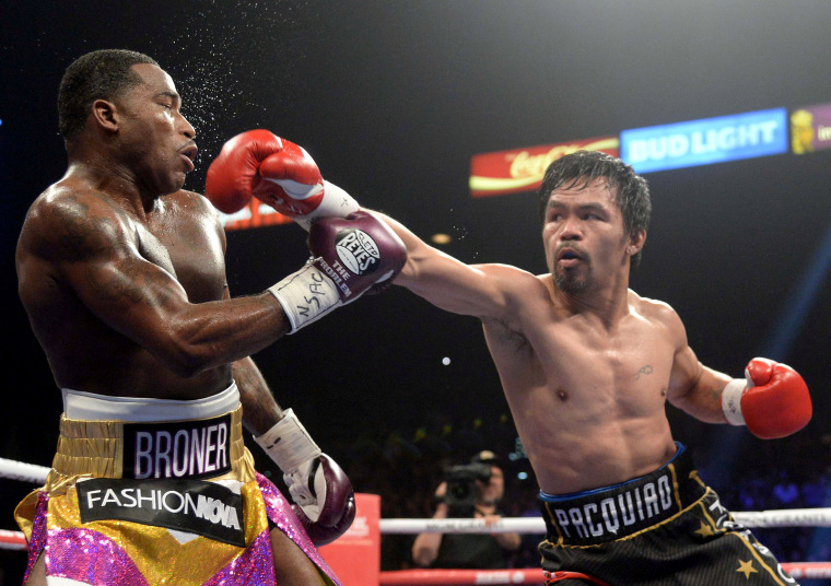 Image: Manny Pacquiao punches Adrien Broner during a welterweight world title boxing match at MGM Grand Garden Arena in Las Vegas on Jan. 19, 2019.