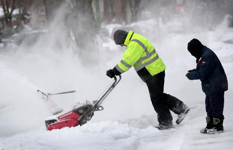 Image: Residents dig out after a snowstorm in Chicago on Jan. 19, 2019.