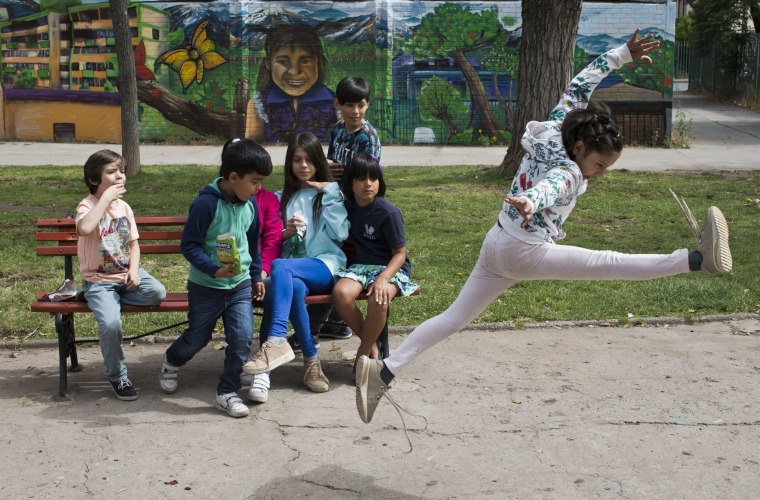 Image: Violeta jumps during recess at the Amaranta Gomez School in Santiago, Chile, on Dec. 11, 2018.