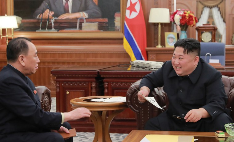 Image: North Korean leader Kim Jong Un talking with Kim Yong Chol