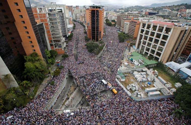 Image: Opposition supporters hold rallies against Venezuelan President Nicolas Maduro's government