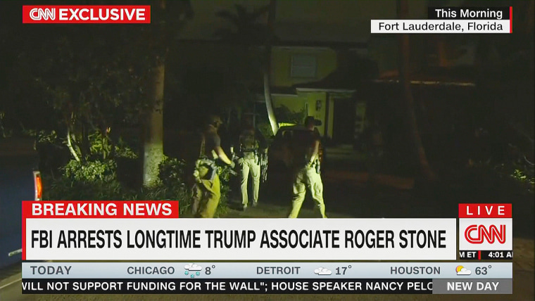 A still from CNN's footage of Roger Stone's arrest.