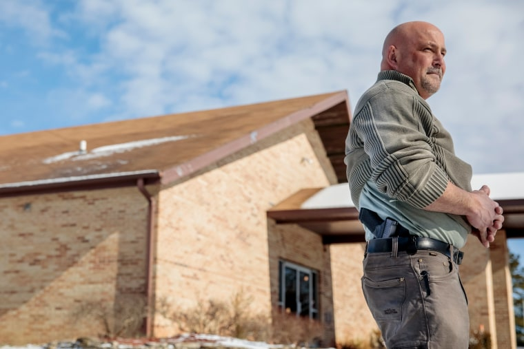 Trampus Taylor, head of the Ava Assembly of God's security team, outside the church in Ava, Missouri.
