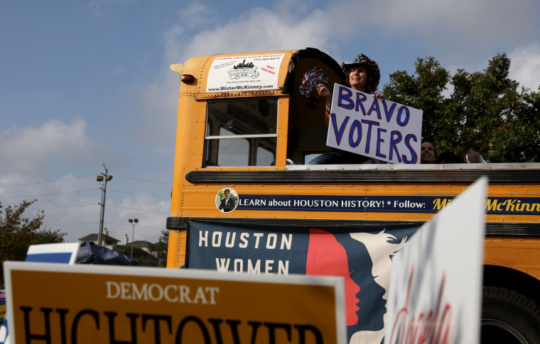 Image: A woman shows support for voters outside the Metropolitan Multi-Service Center polling place in Houston on election day on Nov. 6, 2018.